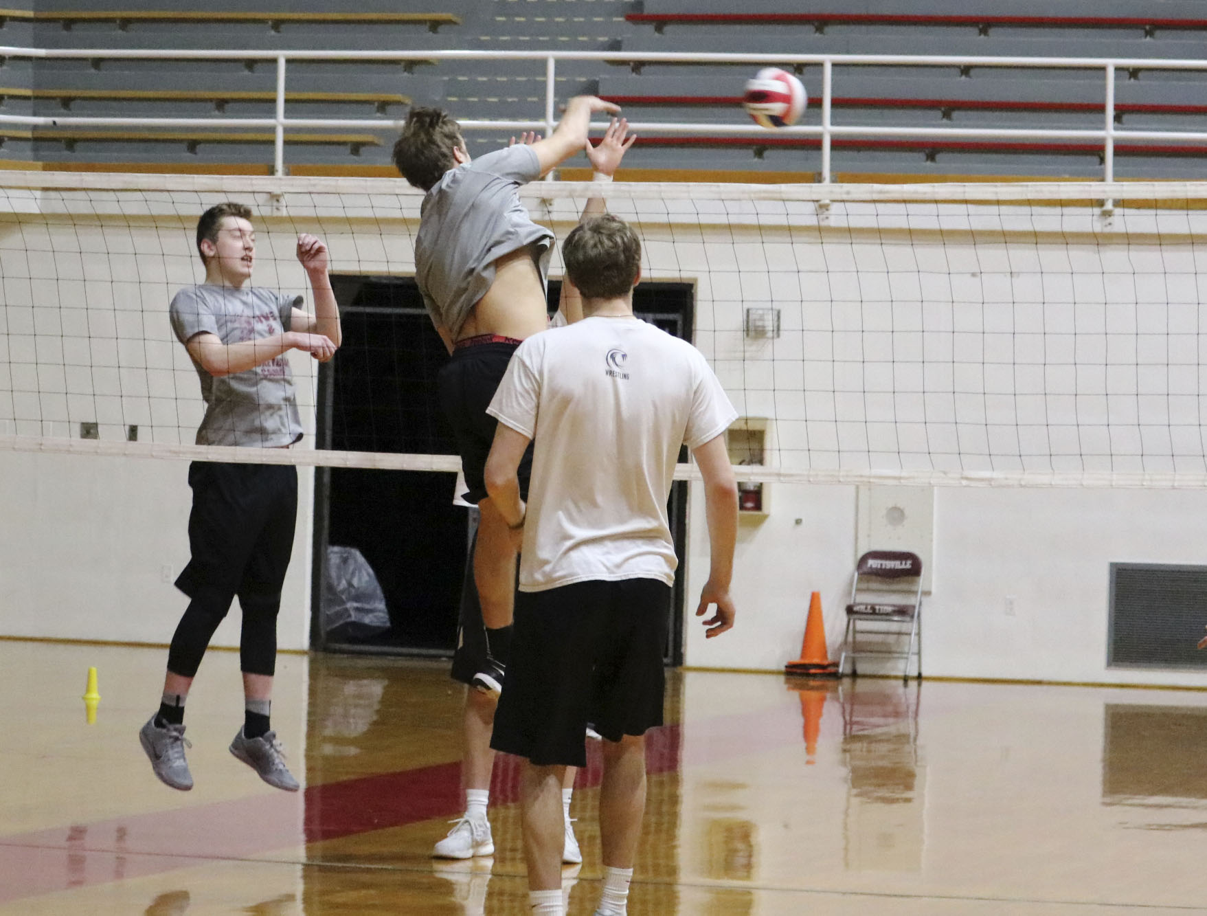 "Junior Ian Renninger spikes the ball at practice. The team played its first match March 30. ""My favorite part is going up to spike the ball,"" Renninger said."