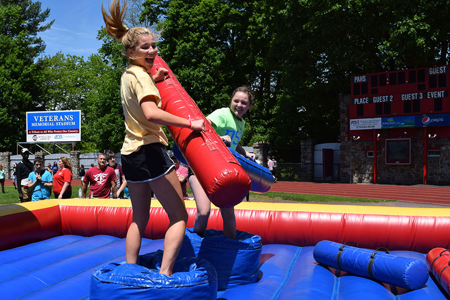 HIT+%E2%80%94+Juniors+Hannah+Sponenburg+and+Olivia+Eagan+battle+it+out+during+a+jousting+tournament.+The+lines+for+this+blow+up+game+and+the+blow+up+obstacle+course+were+consistently+long%2C+but+the+warm+weather+kept+everyone+happy+even+when+waiting+for+their+turns.+%E2%80%9CI+didn%E2%80%99t+think+the+carnival+was+going+to+be+as+exciting+as+it+was.+It+was+way+bigger+and+more+intense+than+I+expected+and+so+much+fun%2C%E2%80%9D+Sponenburg+said.