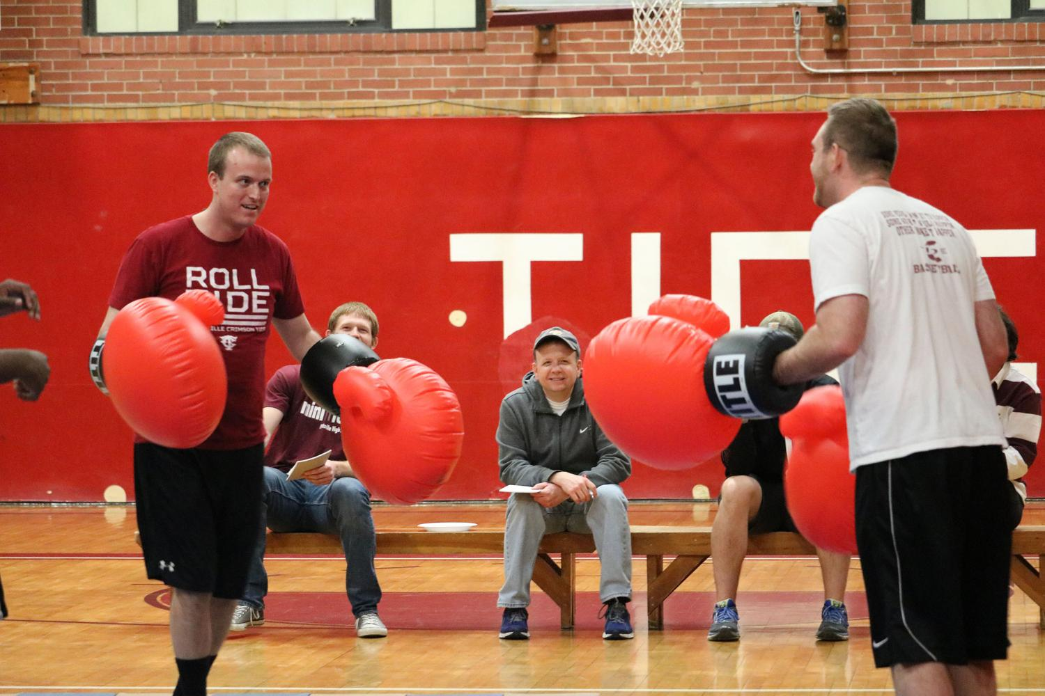 FIGHT-+Mr.+Nathan+Halenar+and+Mr.+Cody+Blankenhorn+help+fight+against+childhood+cancer+by+having+a+boxing+match+as+part+of+the+Mini-THON+fundraiser.+Students+cheered+on+their+favorite+teacher.+At+the+end+of+the+fight%2C+Mr.+Blankenhorn+won.+