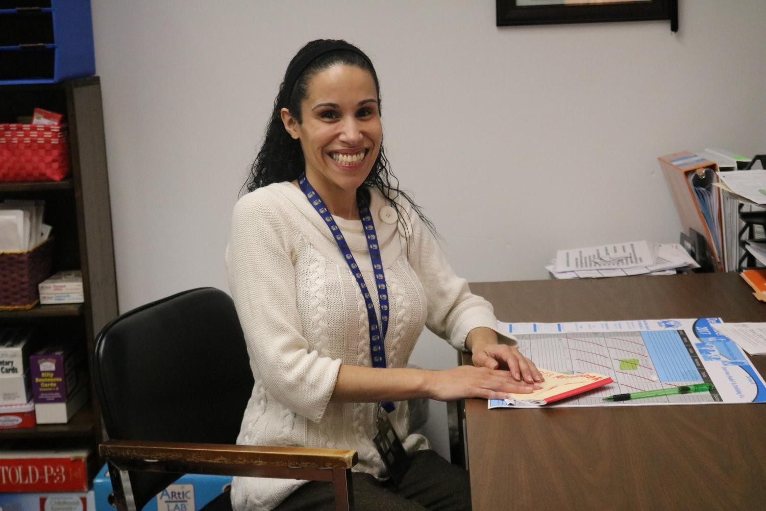 "Mrs. Migdalia Gunoskey, a teacher at PASD, sits at her desk in her classroom. Mrs. Gunoskey is the McKinney-Vento coordinator at PASD, and was a part of ECYEH Awareness Week on November 13-17, 2017. ""This program ensures that homeless children and youth receive free, appropriate, public education,"" Mrs. Gonoskey said."