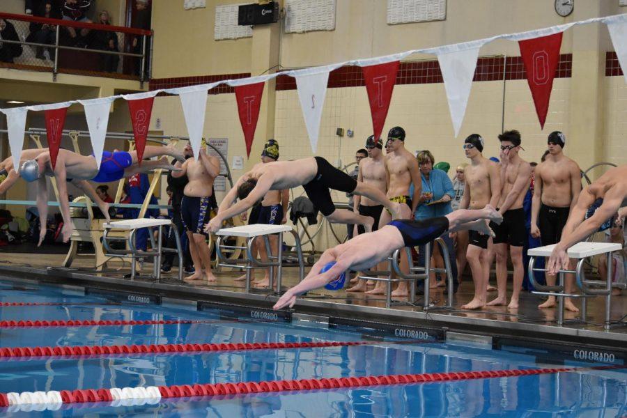 Team leaders and member turnout gear boys' swim team toward successful season