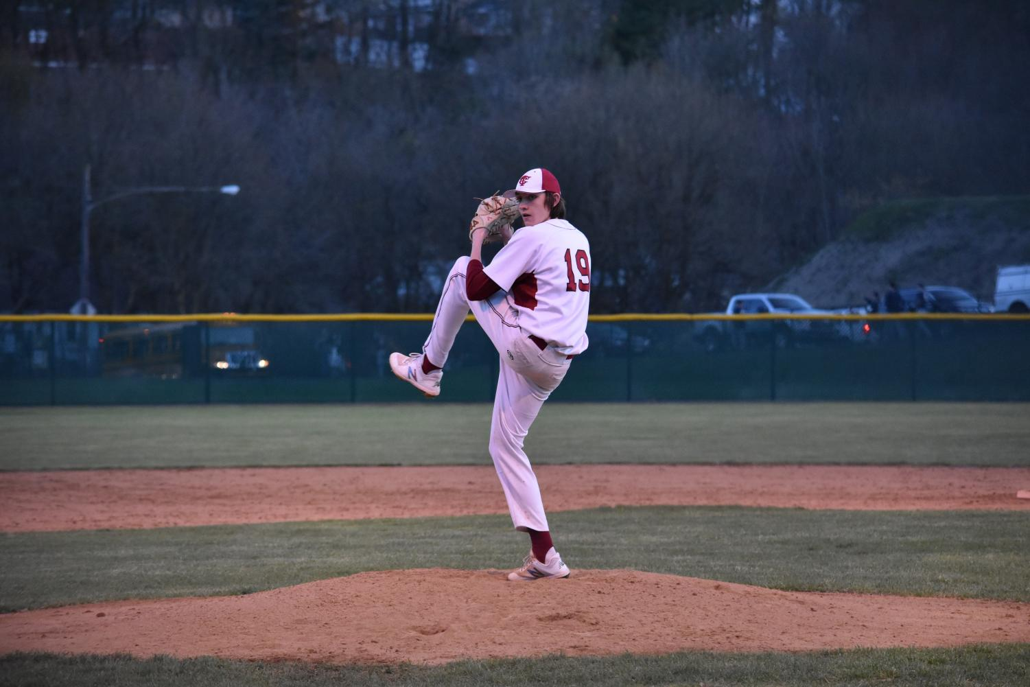 """Senior Noah Nabholz winds up to fire a pitch during a game at Steidle Field. Nabholz and five other seniors have committed to college to play a sport. """"I chose Shippensburg because they showed the most interest in me. The coaches were always calling and texting me, asking how I was doing,"""" Nabholz said."""