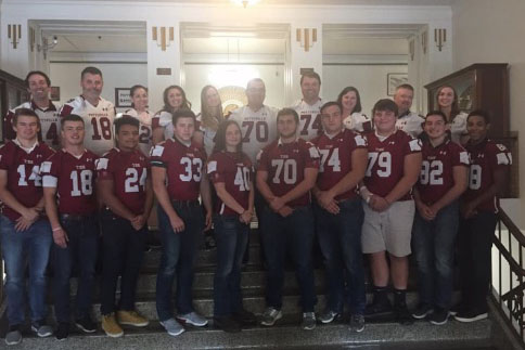 Senior football players and their inspirational teachers