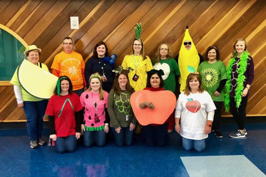 John+S.+Clarke+teachers+dressed+as+a+fruit+salad+pose+for+a+picture.+Teachers+and+students+at+the+elementary+center+held+their+annual+Halloween+parade+on+Friday%2C+October+26.+%E2%80%9CThe+parade+gives+all+the+children+something+to+participate+in+instead+of+doing+math+and+reading.+The+parade+lets+the+community+be+a+part+of+it.+The+parents+get+to+watch%2C%E2%80%9D+Mrs.+Debbie+Lecker+said.%0A