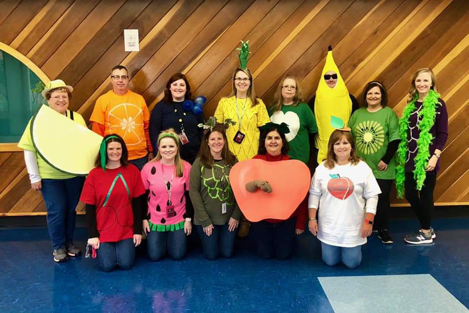 "John S. Clarke teachers dressed as a fruit salad pose for a picture. Teachers and students at the elementary center held their annual Halloween parade on Friday, October 26. ""The parade gives all the children something to participate in instead of doing math and reading. The parade lets the community be a part of it. The parents get to watch,"" Mrs. Debbie Lecker said."
