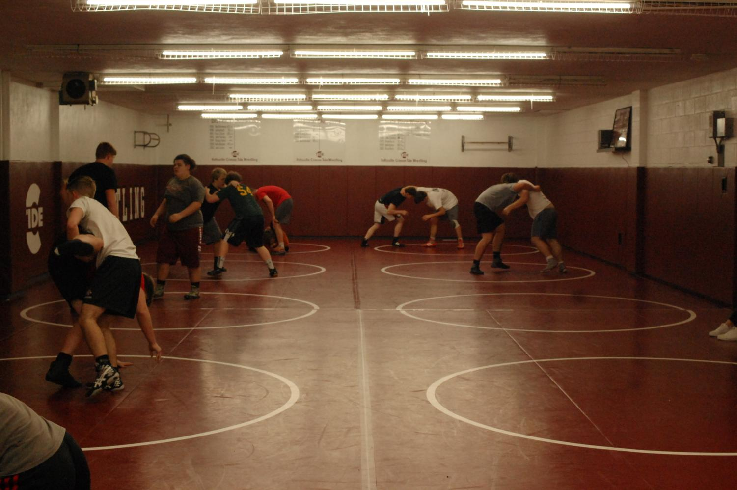 Wrestlers practice their moves.