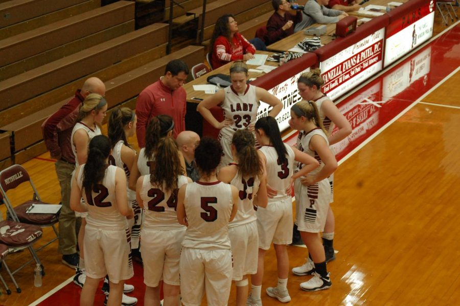 The+girls+varsity+basketball+team+discusses+the+game+during+a+timeout.+