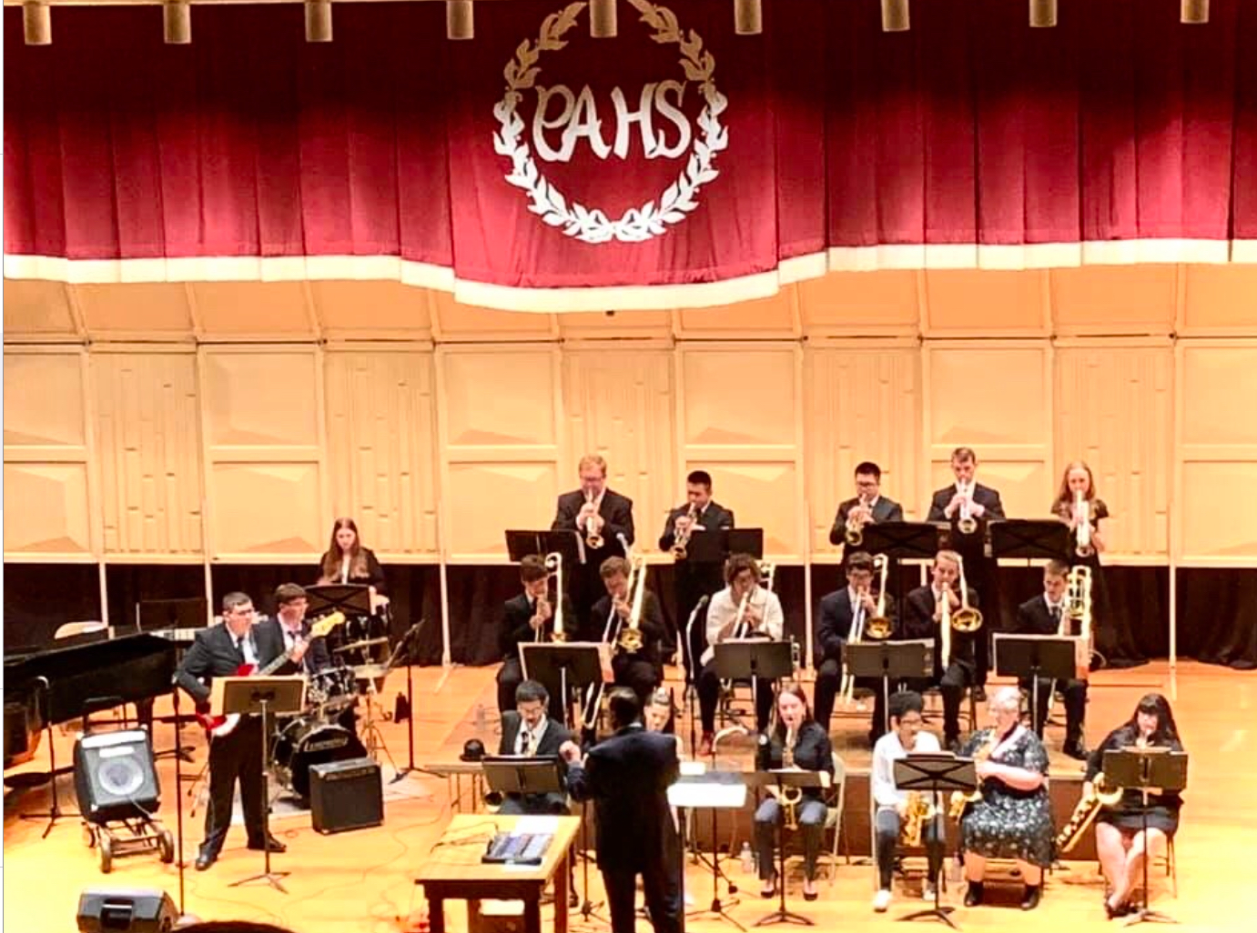 """Stage Band is performing at their spring concert. They provided music for the community to enjoy. Senior Olivia Tokonitz said,""""I love entertaining people with different styles of music."""""""