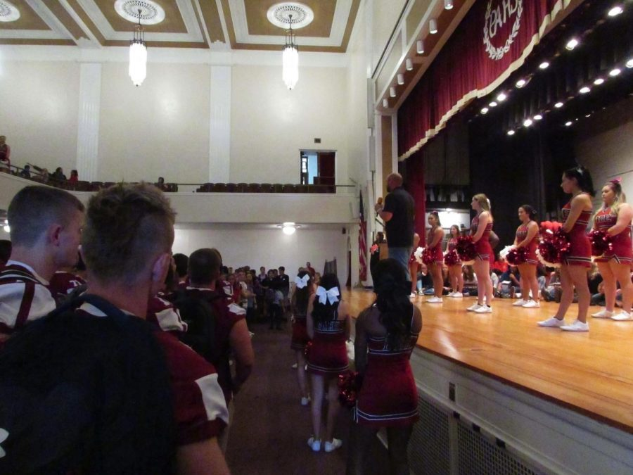 PAHS+cheerleaders+perform+at+the+first+pep+rally.+Some+of+the+cheers+they+showed+were+%E2%80%9CGive+a+Yell%E2%80%9D+and+%E2%80%9CGo+Big+Red.%E2%80%9D++Senior+Isabella+Woodford+%5Bin+the+audience%5D+said%2C+%E2%80%9CThe+pep+rallies+before+the+game+are+most+memorable+and+one+of+the+best+parts+of+the+week.%E2%80%9D+