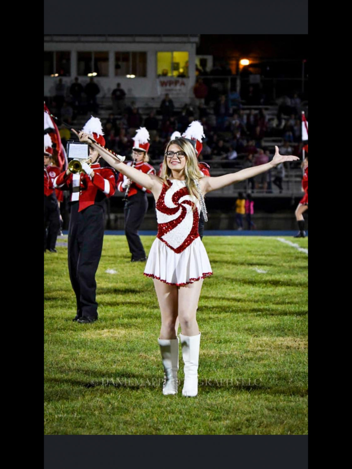 "Allie Murton, Co-Captain of the majorette squad twirls her baton at the Pottsville vs Tamaqua game. "" It has been a stressful year but I enjoy being able to decide which uniform we should wear and what I want to do routine wise. I'll miss being with my girls and messing around during the games and having fun with everyone."""