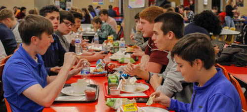 """Featured students enjoy their Thanksgiving meal provided by the PAHS lunch staff. This lunch excited some students for the upcoming holiday. Sophomore Evan Woodward said, """"I appreciate how the school adds variations to the lunches such as the Thanksgiving preview."""""""