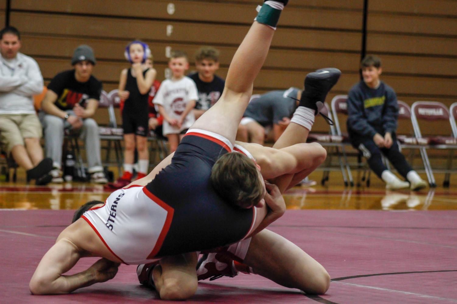 "On Sunday evening, freshman Dalton Monger attempts to pin teammate, junior Sammy Sterns. The proceeds from the event benefited the family of Jaden Leiby in paying for his medical bills. Teammate sophomore Bryce Shappell, who also wrestled that night, said, ""It felt good to wrestle for a great cause."""