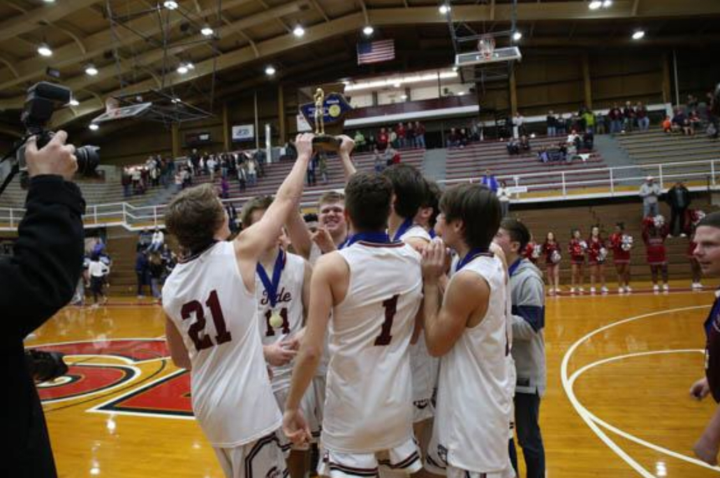 """Pottsville Boys Basketball players hold up the Schuylkill League Championship trophy after their victory over Blue Mountain 51-35 on February 16, 2019. The Pottsville Boys Basketball Program has won multiple Schuylkill League  championships, District championships, and has made appearances in states throughout the past twelve years. """"We have high expectations for this  upcoming season. I feel like this team could produce one of the best seasons we've  ever had as a program,"""" Senior Mason Barnes said."""