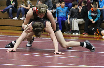 Varsity wrestlers capture first league title in school history (Photo)