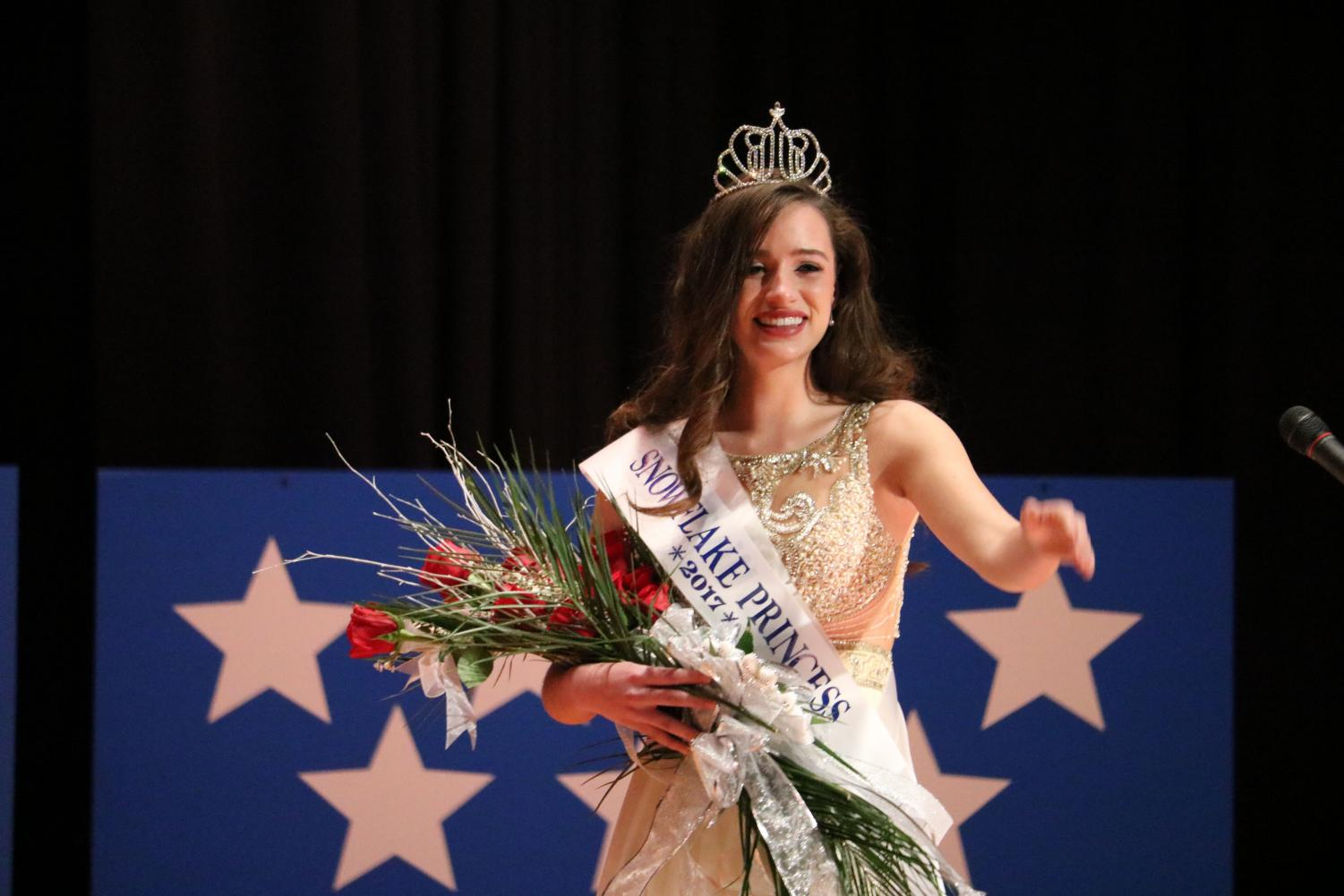 "Senior Hannah Joyce waves to the crowd after being crowned the 2017 Winter Carnival Snowflake Princess. Joyce represented Schuylkill County in various events over the past year. ""Being the Winter Carnival Snowflake Princess has been a learning experience in many ways,"" Joyce said. ""I am looked up to by little girls, so it is important that I am a role model for them. I take that very seriously."""