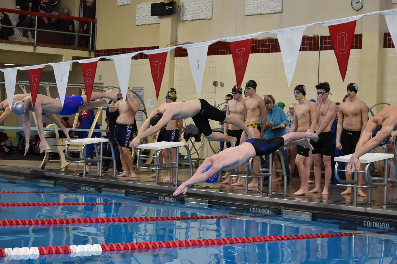 """LAUNCH - At the start of the boys' 400 free relay, senior Josh Zelinsky, middle, dives into the pool. The relay team of Zelinsky, juniors Zach Turnitza and Jordan Young and freshman Zaidian Vanorden set the record with a time of 3:28.8 at the Schuylkill Sprint meet held January 6 at the Ned Hampford Natatorium. """"We are using setting the record to drive us to win districts. We all have been working very hard to get this,"""" Zelinsky said. """"These accomplishments aren't just for us - they're for Coach Ned Hampford as well. He is the real motivation for our success."""""""