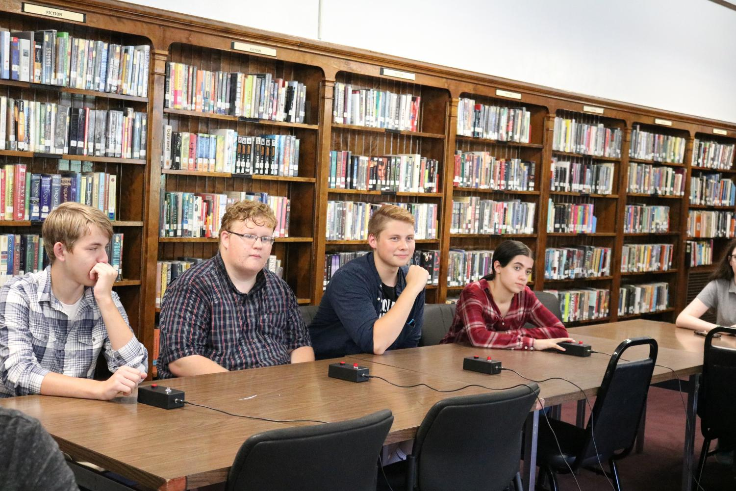 Members of the quiz team at practice listen to the questions until they think they have an answer and buzz in. The quiz team has been going strong under the direction of Mrs. Krista Torpey for three years. Senior Victoria Oswald said,