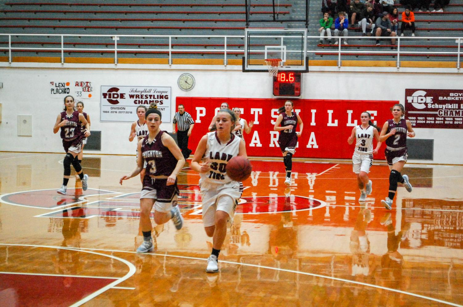 Junior Madison Dalton dribbles the ball in for a layup.