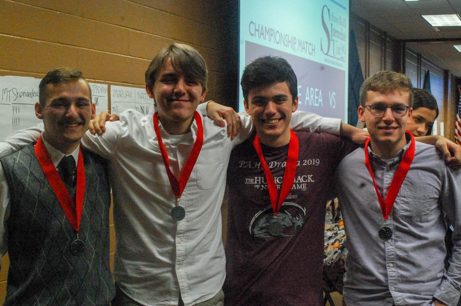 Juniors Kenny Gore, Eli Brennan, senior Evan Spevak and junior Noah Fredricks show off their second place medals at the Schuylkill Quiz Team Championship.