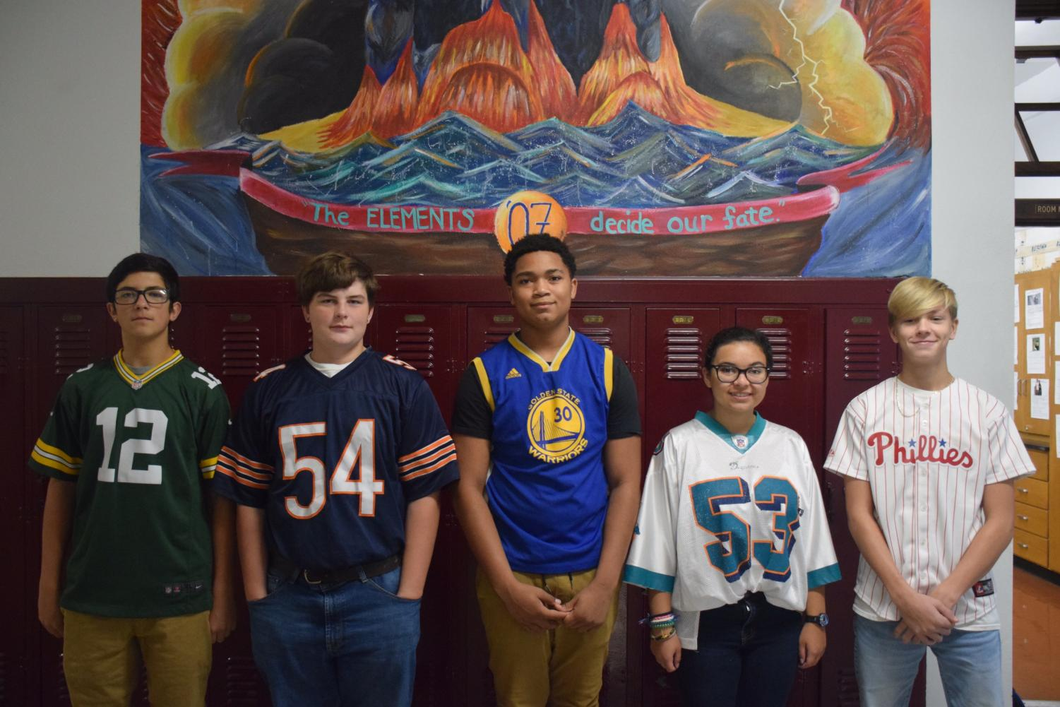 "Students participating in Red Ribbon week stand underneath the 2017 class mural. PAHS allowed students to wear their favorite team jersey or t-shirt on this day. Freshman Mason Major said, ""I grew up a Bears fan and the reason I wore that specific jersey is because I'm inspired by players on the Bears team."""