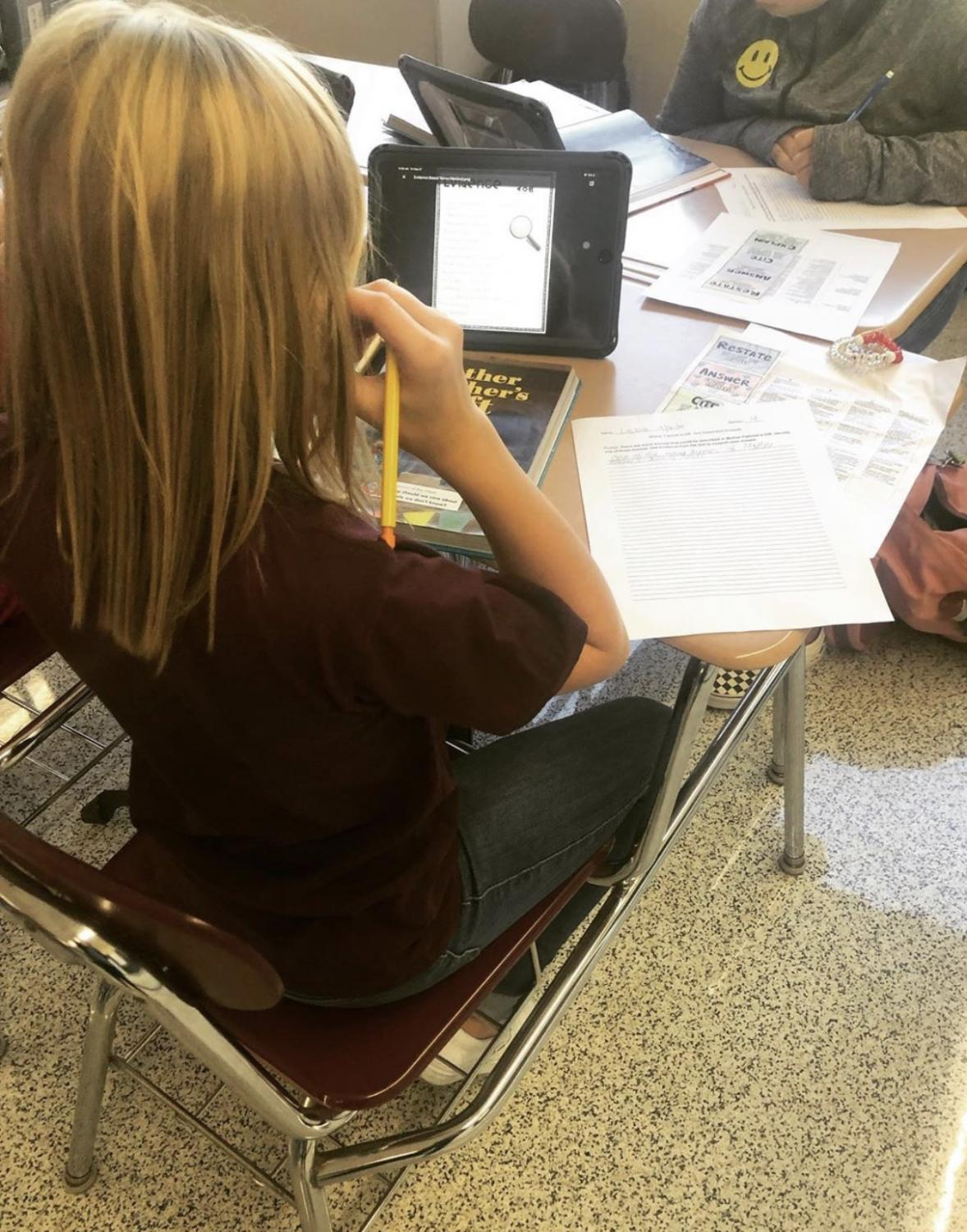 WRITE - Sixth grader Lexie Scanlan uses her iPad to assist in completing a text-dependent analysis assignment in ELA class.