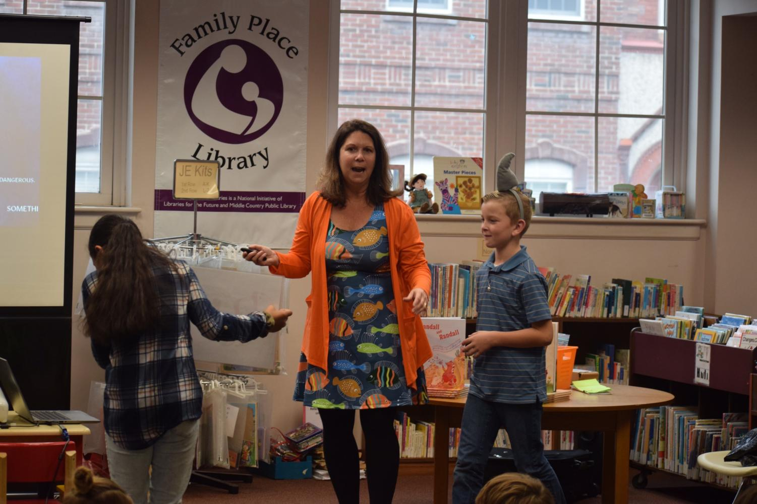 """Nadine Popper, a school librarian and author, engages with students from Mrs. Barr's class. Popper is the author of """"Randall and Randall"""" which she read to the students. """"I enjoyed that the author let the kids participate in the program,"""" said third grader Kennedy Holden."""